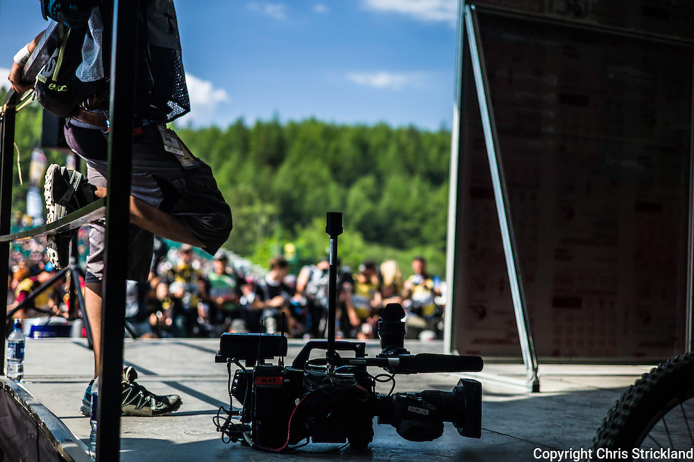 Nevis Range, Fort William, Scotland, UK. 5th June 2016. A TV cameraman waits for the podium presentation. The worlds leading mountain bikers descend on Fort William for the UCI World Cup on Nevis Range.