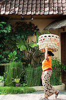 Ubud Street Scene - Woman Carrying Basket on her head, on her way to or from the market.  Carrying things around on the head is still a common sight in Bali.