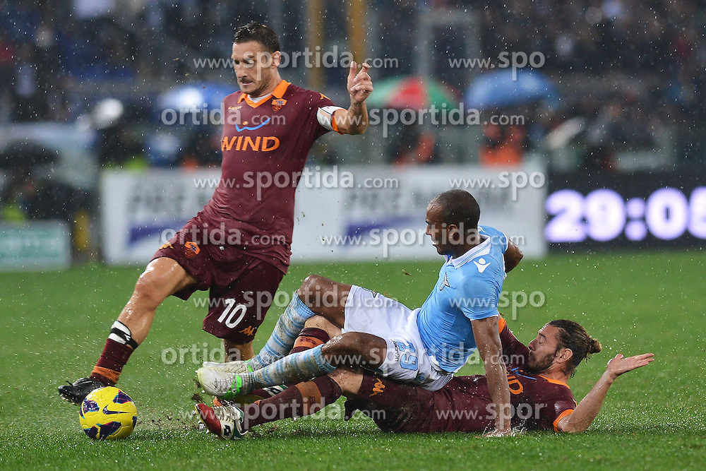11.11.2012, Olympiastadion, Rom, ITA, Serie A, Lazio Rom vs AS Rom, 12. Runde, im Bild Francesco Totti roma, Abdoulay Konko Lazio, Federico Balzaretti Roma // during the Italian Serie A 12th round match between SS Lazio and AS Roma at the Olympic Stadium, Rome, Italy on 2012/11/11. EXPA Pictures © 2012, PhotoCredit: EXPA/ Insidefoto/ Andrea Staccioli..***** ATTENTION - for AUT, SLO, CRO, SRB, SUI and SWE only *****