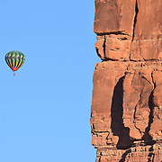 Hot Air Balloons float over the Valley of the Gods, Southern Utah.  The Bluff Balloon Festival is an annual event and one of the best locations for Balloons floating above red rock landscapes.