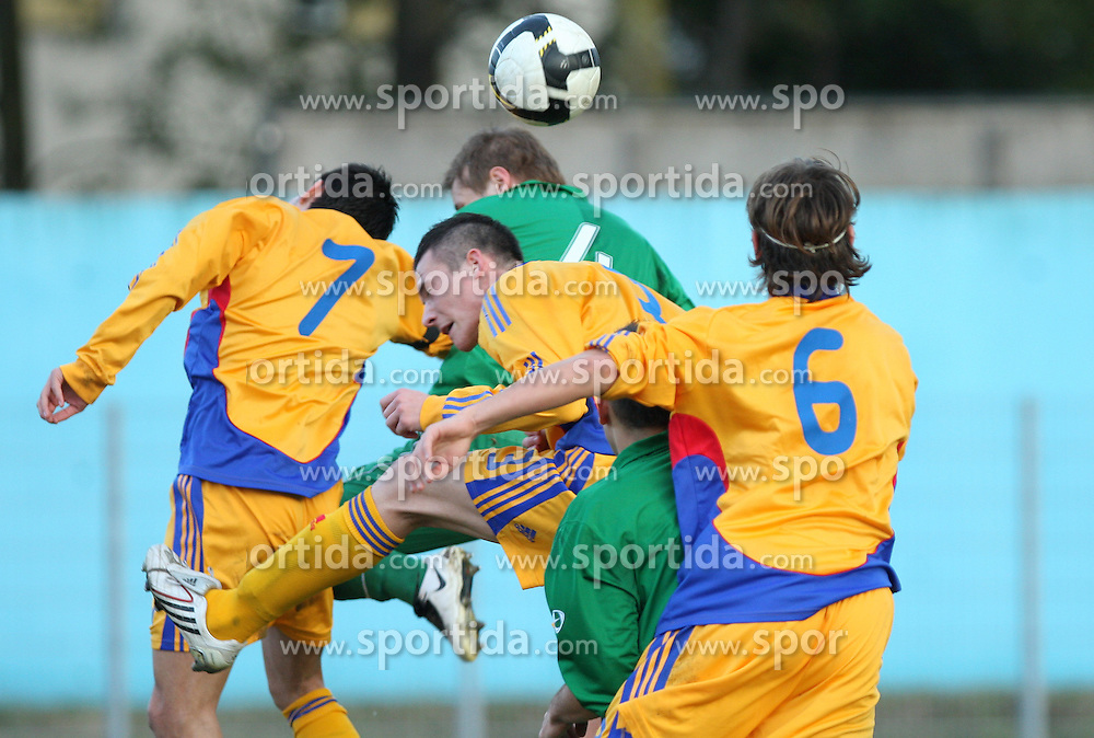 Jumping for the ball during Friendly match between U-21 National teams of Slovenia and Romania, on February 11, 2009, in Nova Gorica, Slovenia. (Photo by Vid Ponikvar / Sportida)