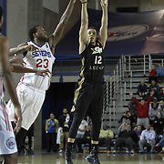 Erie BayHawks Guard Seth Curry (12) attempts a three point shot as Delaware 87ers Forward Victor Rudd (23) defends in the second half of a NBA D-league regular season basketball game between the Delaware 87ers and the Erie BayHawk (Orlando magic) Friday, Jan. 02, 2015 at The Bob Carpenter Sports Convocation Center in Newark, DEL
