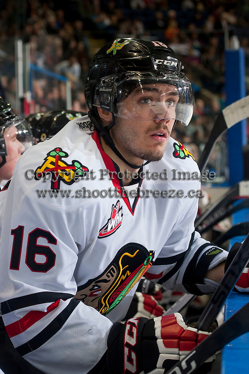 KELOWNA, CANADA - NOVEMBER 22: Blake Heinrich #16 of Portland Winterhawks sits on the bench against the Kelowna Rockets on November 22, 2014 at Prospera Place in Kelowna, British Columbia, Canada.  (Photo by Marissa Baecker/Shoot the Breeze)  *** Local Caption *** Blake Heinrich;
