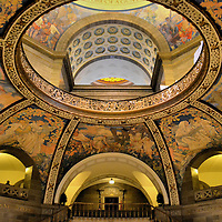 Missouri State Capitol Rotunda Dome in Jefferson City, Missouri<br /> The Missouri State Capitol in Jefferson City is adorned with exquisite, regionalism murals. The paintings by Thomas Benton portray early Midwestern life. They make even hardships seem romantic. Throughout the building is a treasure of carvings, statues, stained glass, flags, artifacts and other murals. Together they show you the history of the &ldquo;Show Me State.&rdquo;