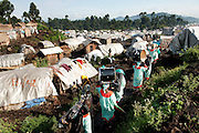 Through spirituality and faith, people overcome sorrow.<br /> Catholic community from Kitchanga going to a displaced people camp, to celebrate a mass.