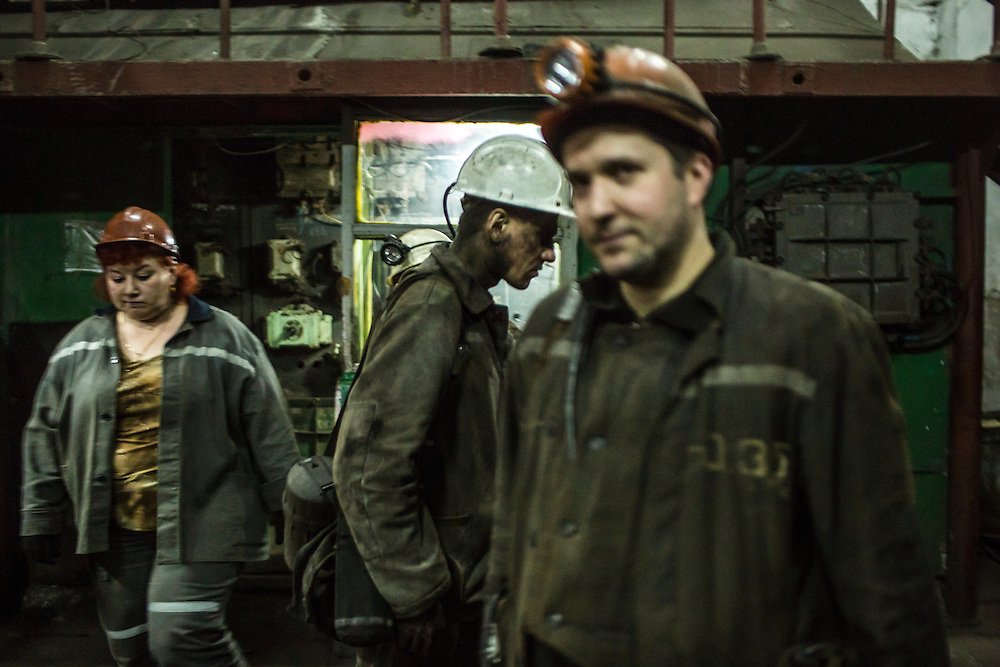 Miners at the surface after being underground at the Shcheglovskaya Coal Mine on Friday, March 25, 2016 in Makiivka, Ukraine.