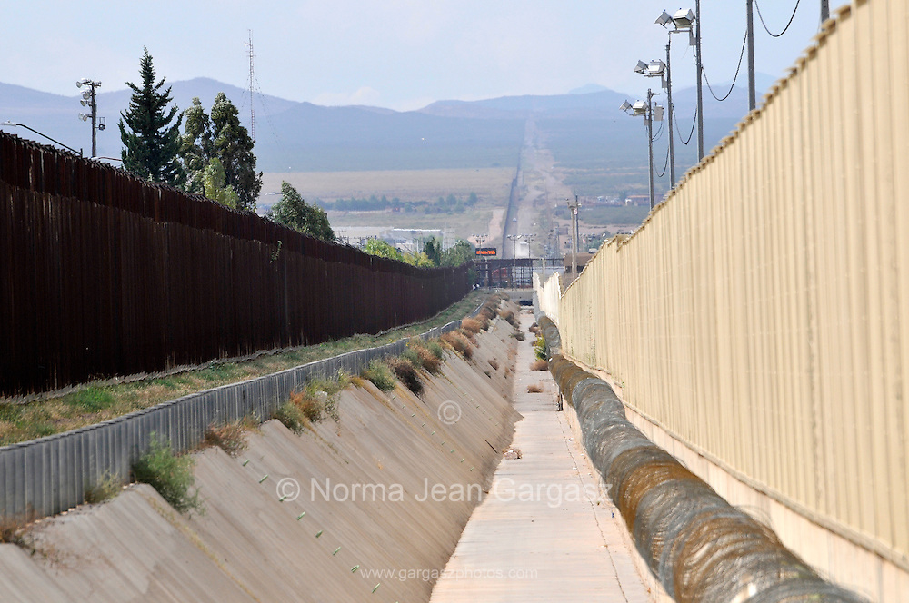 A culvert runs along the international border wall between Agua Prieta, Sonora, Mexico, and Douglas Arizona, USA, as seen from Arizona.