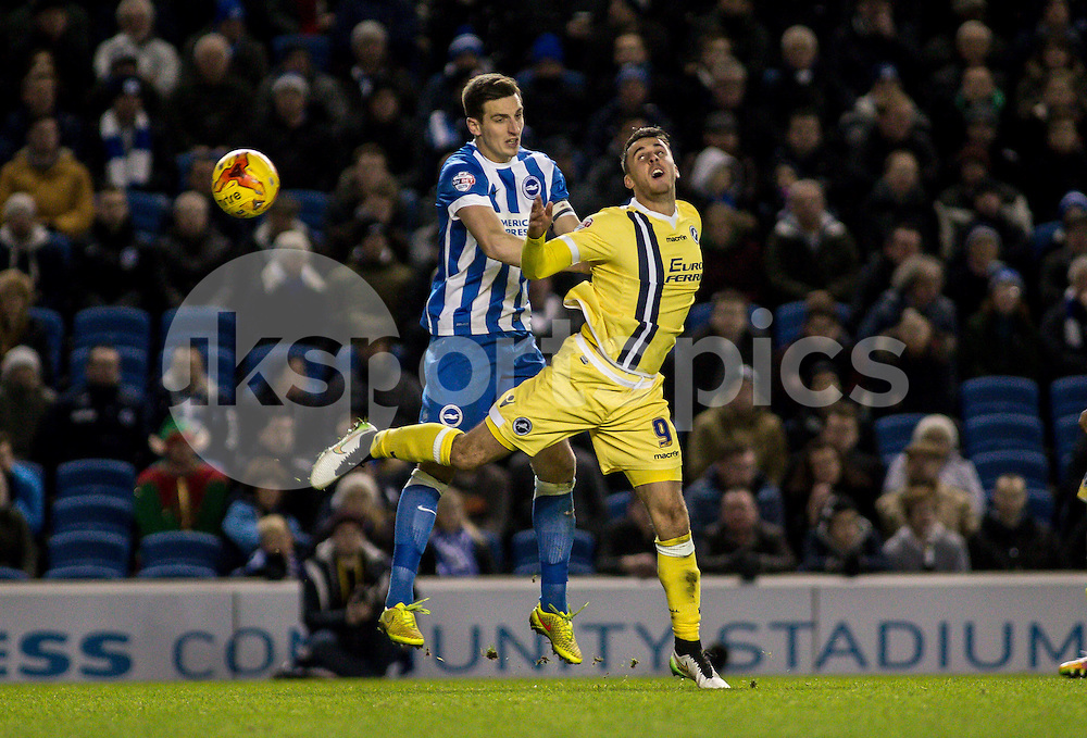 Lee Gregory of Millwall flicks on while under pressure from Lewis Dunk of Brighton during the Sky Bet Championship match between Brighton and Hove Albion and Millwall at the AMEX Stadium, Brighton, England on 12 December 2014. Photo by Liam McAvoy.