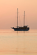Yacht at sunset in the Maldives.