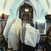 Orthodox Jewish men covered with ritual prayer shawls (Talisem) at morning prayer in the Ben Ari Synagogue in Tsfat (Safed) Israel.