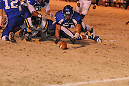 Water Valley's Justin McCammon (54) dives on a fumble vs. Cleveland Eastside in Water Valley, Miss. on Friday, November 18, 2011.