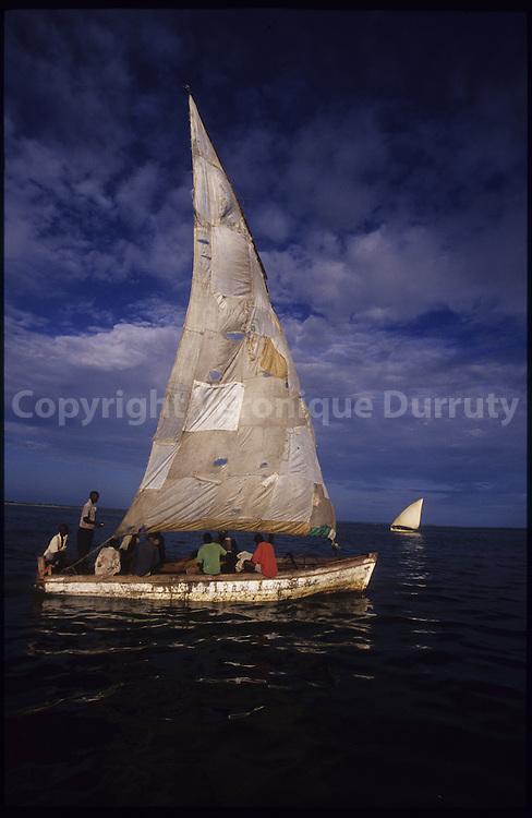 Fisherman boat. Sails of the boat shows  how life is difficult for the island s fishermen.   Bateau de pecheur. .L etat des voiles laisse presager les difficultes de la vie des pecheurs de l ile....
