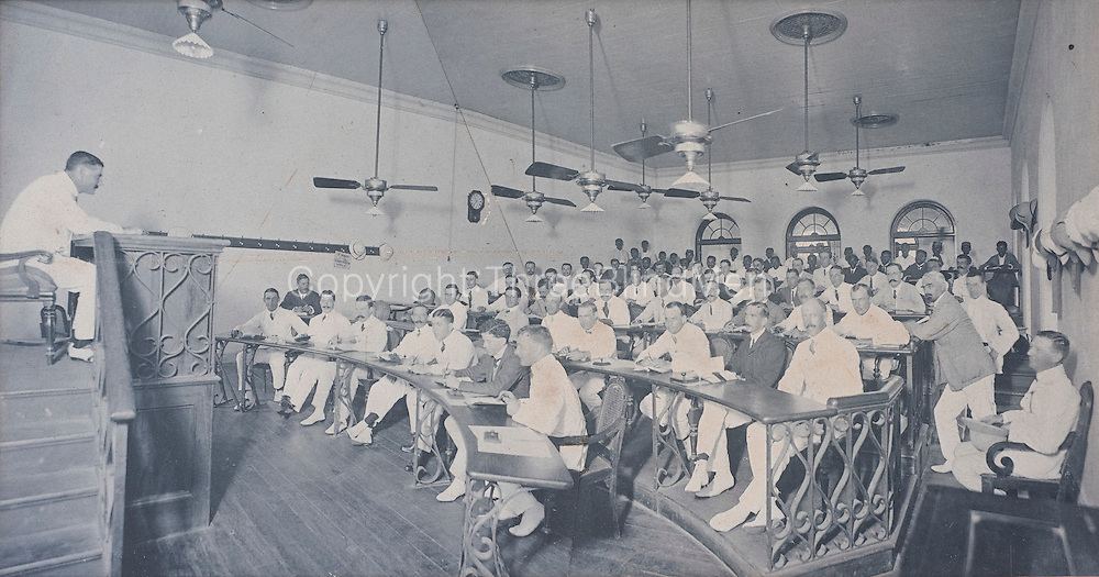 Tea Auction in progress at the Ceylon Chamber of Commerce - sale room. 1909<br />