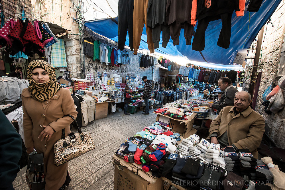 A buzzling street of a part of Hebron old Arab market left open by the Israeli army.