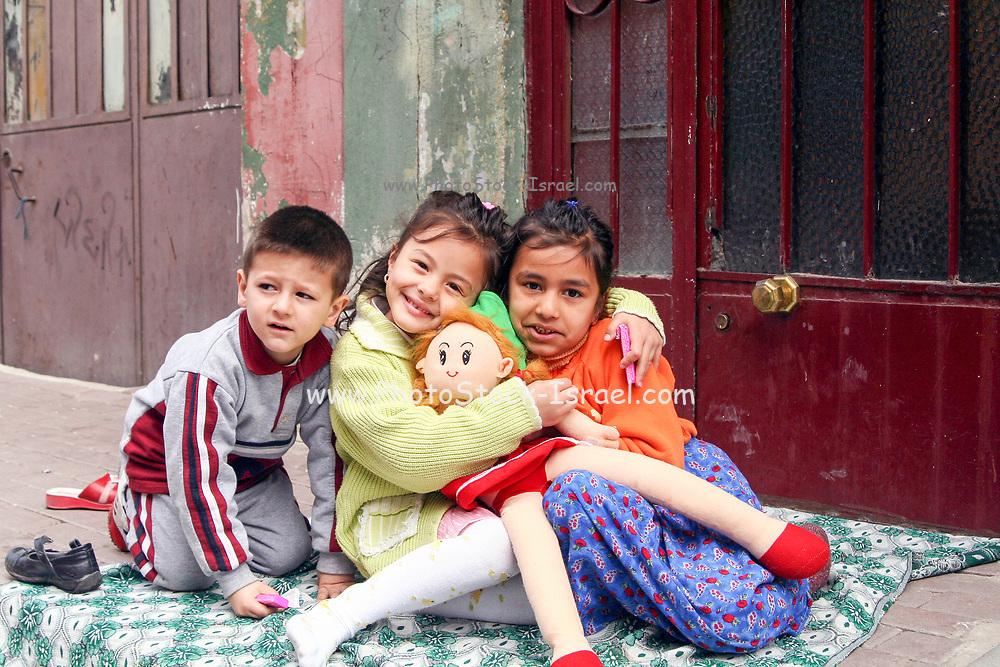 Turkish children playing in a street in Istanbul, Turkey