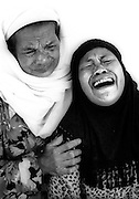 A woman breaks down as she realises she has lost four members of her family to the Tsunami that struck Banda Aceh on December 26th, 2004. Kesdam Hospital, Banda Aceh, Indonesia.