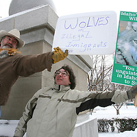 "Hunter and outfitter Barry Peterson of Rupert tries to use his sign to block the sign of wolf supporter Rick Hobson of Boise during a rally held on the Idaho Statehouse steps by Sportsmen for Fish and Wildlife - Idaho on Thursday. SFW-Idaho is holding a statewide petition drive demanding a change in policy toward state management of Idaho's wolf population. ""We've got to do something about all the illegal immigrants coming into the forest,"" Peterson said of the wolves. ""I think the wolves need a voice,"" Hobson said."