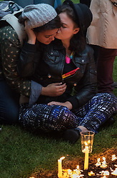 Church of St. Ann, Soho, Soho, London, June 13th 2016. Thousands of LGBT people and their friends converge on Old Compton Street in London's Soho to remember the fifty lives lost in the attack on gay bar Pulse in Orlando, Florida. PICTURED: Two women comfort each other in the churchyard of Church of St. Ann, Soho
