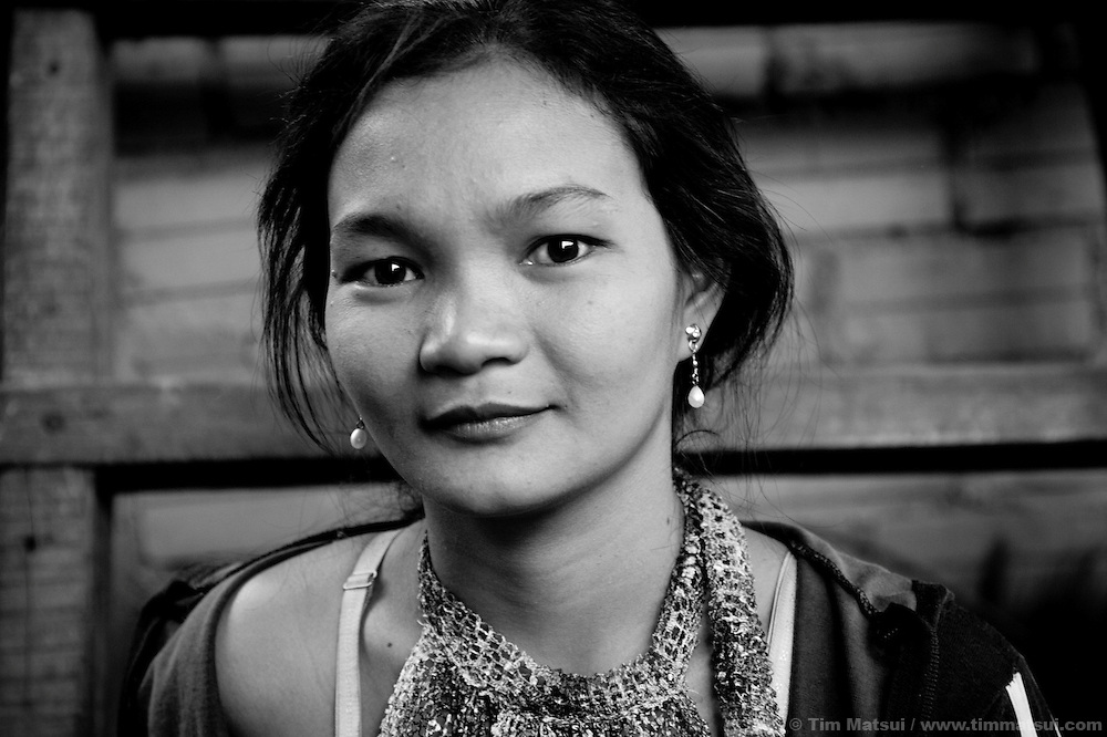 """Srey B, a prostitute living in a slum where """"Acting for Women in Distressing Situations"""" (AFESIP) conducts outreach and provides services, in Phnom Penh, Cambodia. The slum's permanent structure, a decaying four story building known simply as 'The Building', was built in the 1960's as transitional housing and now hosts a shantytown where many of the city's poor live, including many prostitutes, and is believed to have the highest rate of HIV infection in the city. AFESIP hands out free condoms, instructs prostitutes on HIV prevention, and conducts outreach in case the prostitutes need medical services, choose to leave their profession, or can report on cases of sex trafficking. AFESIP offers housing, education, training, and counseling for women who are victims of sex trafficking, worked as prostitutes, or are escaping domestic violence. Founded by Somaly Mam, who herself was once a prostitute and victim of trafficking and domestic abuse, AFESIP has three facilities in Cambodia and works with other NGO's to provide long term care for the women."""