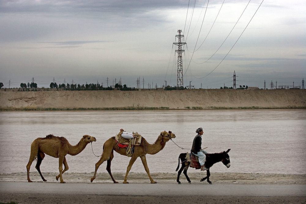 Power lines stretch accross the river border between Uzbekistan and Afghanistan at Hairaton. Northern Afghanistan on the 10th of April 2009.