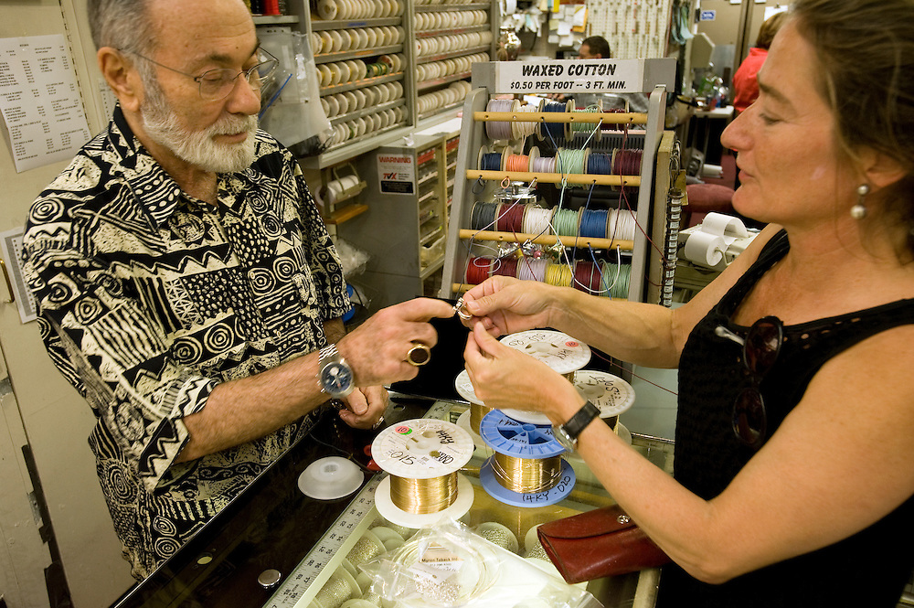 Jewelry supply store owner Myron Toback (left) and jewelry maker Barbara Epler discuss a ring which she designed and made recently...Diamond District New York on 47th street between 5th and 6th avenues in midtown Manhattan . The Diamond District is the world's largest shopping district for all sizes and shapes of diamonds and fine jewelry. Many suppliers and jewelry makers also have their stores and workshops right on 47th street.