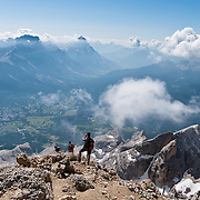 """From the ski resort of Cortina d'Ampezzo, ride a cable car lift to Tofana di Mezzo (3244 meters / 10,643 feet, third highest peak in the Dolomites) in Tofane mountain group, in the Dolomiti (a part of the Southern Limestone Alps), in the Province of Belluno, Veneto region, Italy, Europe. This ski resort hosted the 1956 Winter Olympics and motion pictures including: """"The Pink Panther"""" (1963), """"For Your Eyes Only"""" (1981, James Bond stunt sequences); and """"Cliffhanger"""" (1993). Here at the head of Valle del Boite, nearby peaks include Pomagagnon to the north, Cristallo to the northeast, Faloria and Sorapiss to the east, and Becco di Mezzodì, Croda da Lago and Cinque Torri to south. The Dolomites were declared a natural World Heritage Site (2009) by UNESCO."""