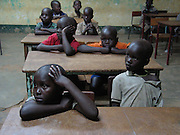 Gulu, Uganda, 2004. A night class at St Joseph's College in nearby Layibi. The class appears to be more of a time filler as it is late and the boys are tired.
