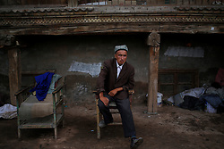A picture made available on 31 May 2013 of a barber of the Uighur  ethnic group waiting for customers outside the old town of Kashgar, western edge of China's Xinjiang Uighur Autonomous Region, China 26 May 2013. Uighurs, a Muslim ethnic minority group in China, make up about 40 per cent of the 21.8 million people in Xinjiang, a vast, ethnically divided region that borders Pakistan, Afghanistan, Kazakhstan, Kyrgyzstan and Mongolia. Other ethnic minorities living in here include the Han Chinese, Kyrgyz, Mongolian and Tajiks people. In the restive region of Kashgar, western end of Xinjiang where the North and South Silk road meets, Uighurs comprise of more than 90 per cent of the 3.9 million population. Most practice a moderate form of Islam and religion is a major part of most ordinary Uighurs' lives. Tensions have been high between the Uighurs and the dominant Han Chinese as Uighurs complain of cultural and religious repression and claim that Han Chinese migrants enjoy the main benefits of development in the oil-rich but economically backward region.