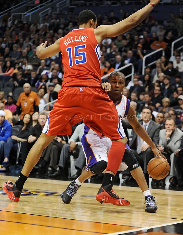 Dec. 23, 2012; Phoenix, AZ, USA; Phoenix Suns guard Sebastian Telfair (31) handles the ball during the game against the Los Angeles Clippers center Ryan Hollins (15) in the second half at US Airways Center. The Clippers defeated the Suns 103-77. Mandatory Credit: Jennifer Stewart-USA TODAY Sports