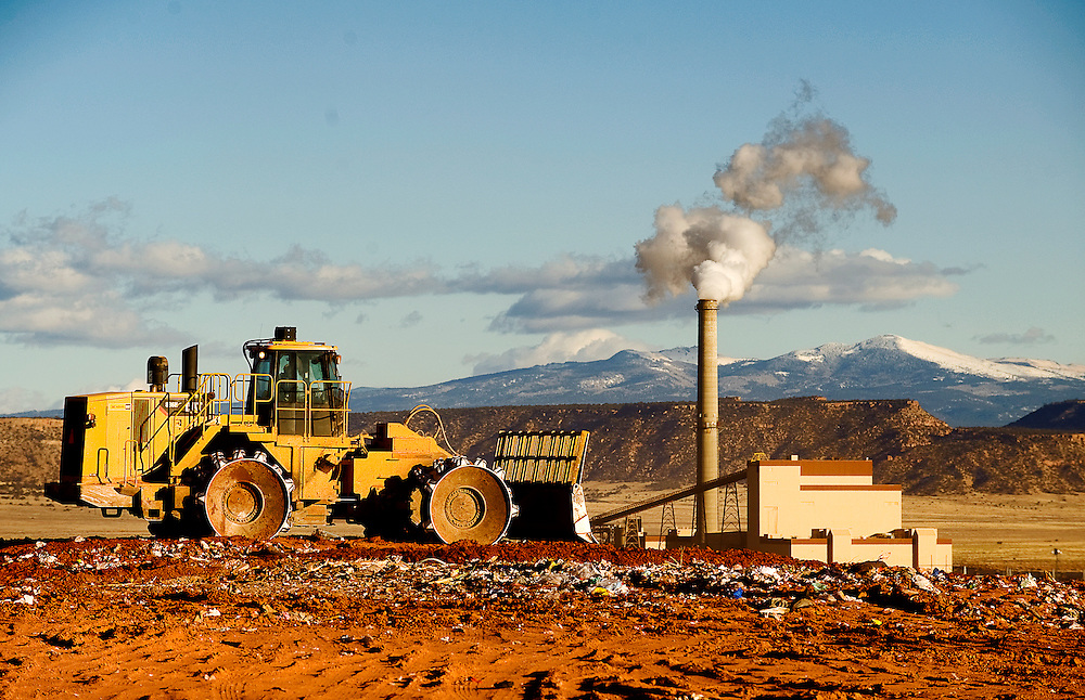 012709     Brian Leddy.A bulldozer covers trash from the days haul at the Northwest New Mexico Regional Landfill in Thoreau on Tuesday. A public hearing was held on Tuesday for the landfill to begin filling in a new pit with trash. The current pile is nearly at full capacity.
