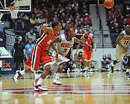 "Ole Miss' Derrick Millinghaus (3) vs. Georgia's Vincent Williams (11) at the C.M. ""Tad"" Smith Coliseum on Saturday, February 16, 2013. (AP Photo/Oxford Eagle, Bruce Newman)"