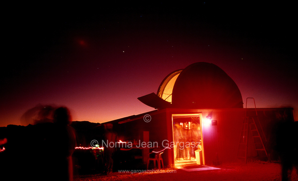 Young visitors at a star gazing party at the Vega-Bray Observatory in Benson, Arizona, look through telescopes at dusk.