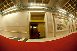A picture taken with a fisheye lens of a Chinese security officer guarding an entrance during the opening session of the National Peoples Congress (NPC) in the Great Hall of the People in Beijing, China, on 05 March 2011. The NPC has over 3,000 delegates and is the world's largest parliament or legislative assembly though its function is largely as a formal seal of approval for the policies fixed by the leaders of the Chinese Communist Party.
