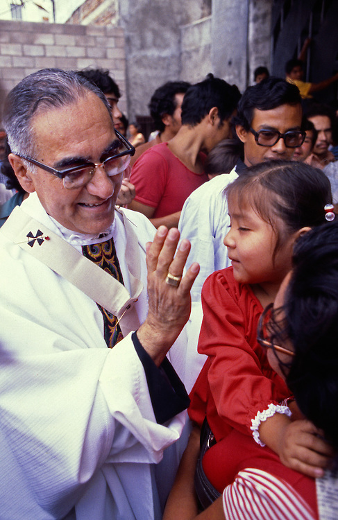 The martyr Archbishop Oscar Romero of El Salvador is greeted by his parishioners at a mass at Iglesia el Rosario -the Church of the Rosary - in San Salvador, El Salvador. The priest was later slain at the alter by a right wing gunman in 1980. Óscar Arnulfo Romero y Galdámez was a bishop of the Catholic Church in El Salvador. He became the fourth Archbishop of San Salvador, succeeding Luis Chávez, and spoke out against poverty, social injustice, assassinations and torture. Romero was assassinated while offering Mass on March 24,1980. To license this image, click on the shopping cart below -