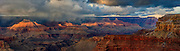 Turbulent Cluds, Winter Storm, Evening Sun breaking through illuminating the mesas and temples. Available as fine art print, canvas gallery wrap or licensed use
