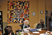 Canada, Ontario Windsor, 2016. Artist Trading Card workshop at Ten Thousand Villages is a MayWorks Windsor 2016 event. Susan Gold, centre, points to the MayWorks Windsor 2016 quilt given to Ten Thousand Villages for their community work.