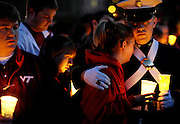 Those inside and outside the Virginia Tech family gathered on the Drillfield for a candlelight vigil in honor of those who were killed or injured during an attack on the campus the day before by a homicidal student.