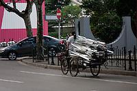 chinese women on bike with aluminium loaded in Shanghai China