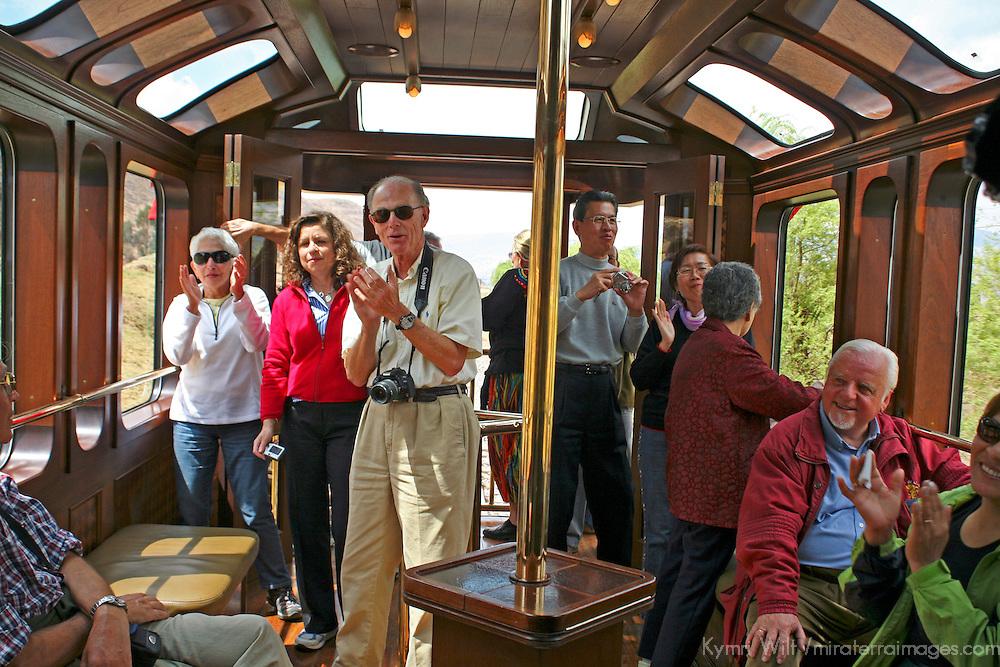 South America, Peru. Travelers enjoying the bar car of the Hiram Bingham luxury train to Machu Picchu.