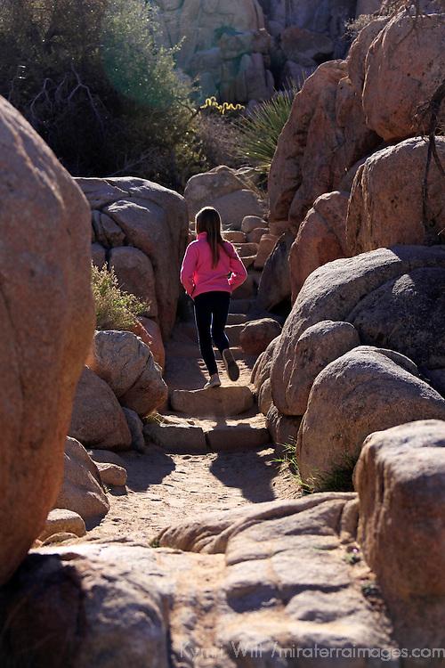 USA, California, Joshua Tree. Girl on Hidden Valley Trail in Joshua Tree.