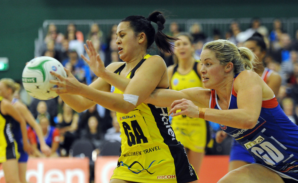 Pulse's Paula Griffin, left, under pressure from Mystics' Julie Corletto in the ANZ Championship netball, Arena Manawatu, Palmerston North, New Zealand, Sunday, May 18, 2014. Credit:SNPA / Ross Setford