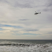 Helicopters check the area of the Atlantic Ocean contaminated by the disaster