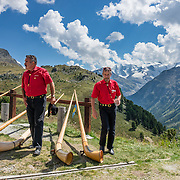 """Hear an alpenhorn concert at Alp Languard, reached via chairlift above Pontresina in Upper Engadine, in Graubünden (Grisons) canton, Switzerland, the Alps, Europe. The Swiss valley of Engadine translates as the """"garden of the En (or Inn) River"""" (Engadin in German, Engiadina in Romansh, Engadina in Italian). For licensing options, please inquire."""