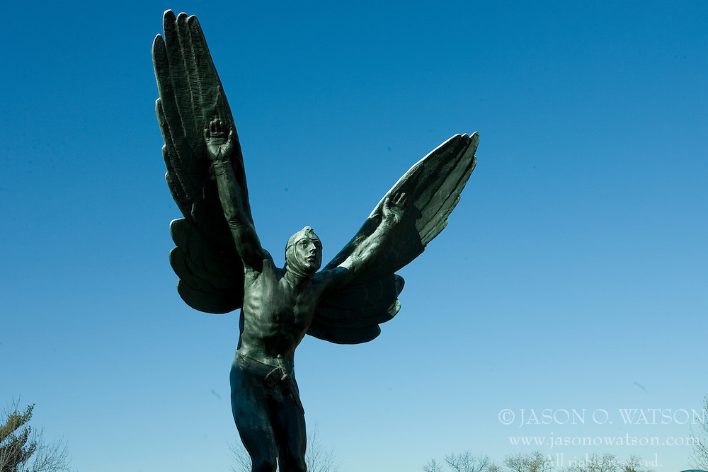 Flying Man statue outside Clemons Library and Alderman Library, University of Virginia.