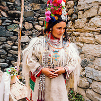 A Drokpan woman waiting for her relatives to join her before going to a festival in Ladakh, Jammu & Kashmir.