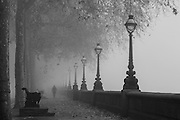 Figure in the fog along the Chelsea Embankment on a foggy December morning