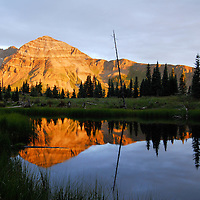 Wide angle view of high altitude mountain in pond