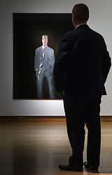 """Christies, St James, London, February 5th 2016. A man admires Michelangelo Pistoletto's """"Il Presente. Figura su sfondo nero V (The Present. Figure on a Black Ground V)"""", which is expected to fetch up to £550,000 at auction, during the 20th Century Art Sale Preview. ///FOR LICENCING CONTACT: paul@pauldaveycreative.co.uk TEL:+44 (0) 7966 016 296 or +44 (0) 20 8969 6875. ©2015 Paul R Davey. All rights reserved."""