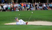 Matt Kuchar hits out of the bunker on the 18th green to win the final round of the RBC Heritage golf tournament in Hilton Head Island, S.C., Sunday, April 20, 2014. Kuchar won the tournament with 11-under par. (AP Photo/Stephen B. Morton)