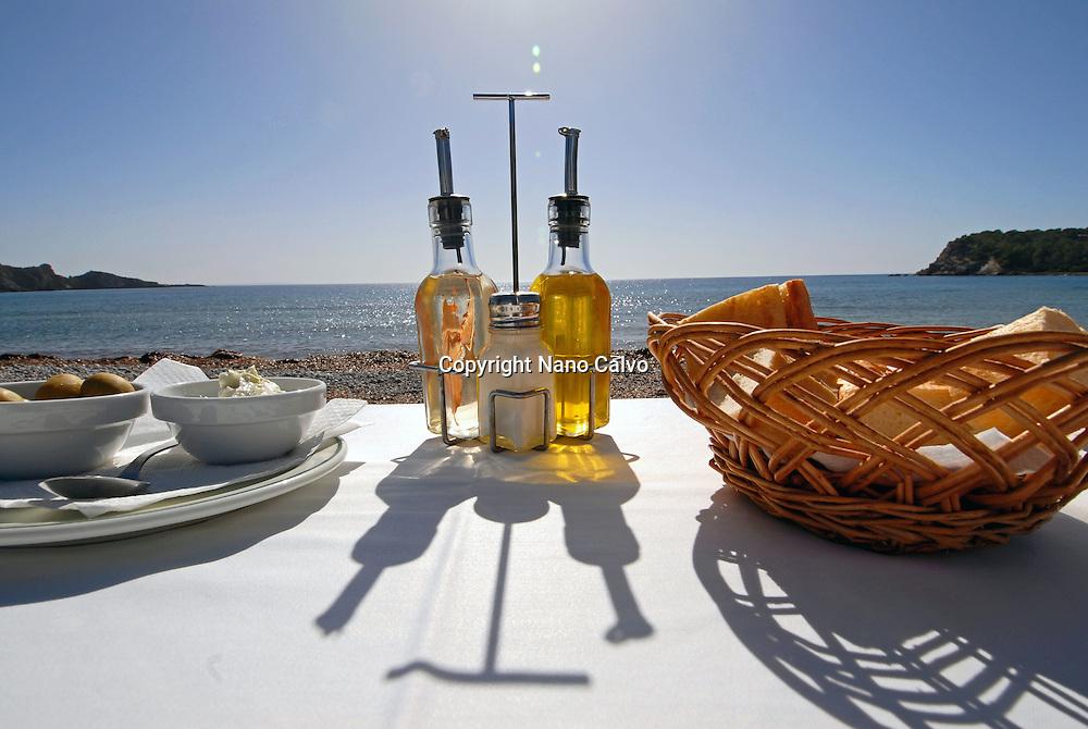 Bread, olives and alioli in Tropicana, a popular beach restaurant in Cala Jondal, Ibiza